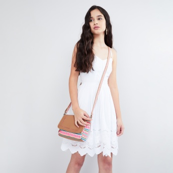 MAX Laser Cut-Out Embroidered Sling Bag